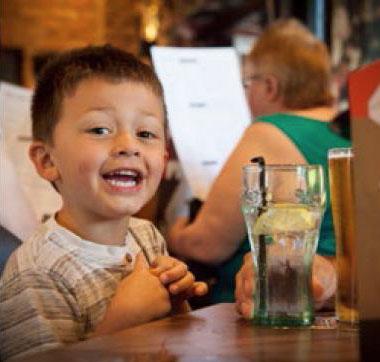 Happy kid enjoying a drink